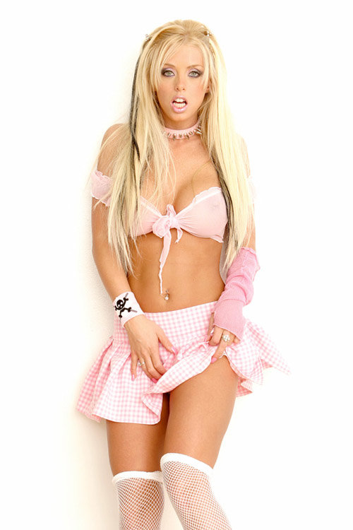 Эротические фотографии молоденькой девушки в розовой юбочке