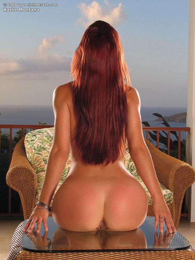Эротические фото рыженькой девушки-секси в красной юбке